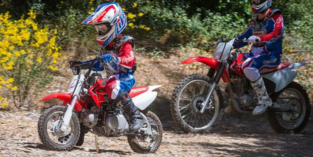 kids on a dirt bike